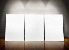 Three posters standing in line Stock Image