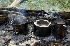 Three pot with boiling water stand Stock Image
