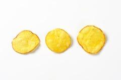 Three potato chips Stock Photos