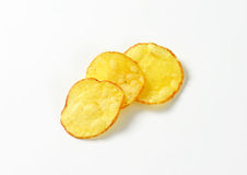 Three potato chips. On white background Royalty Free Stock Image