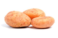 Three potatoes. Isolated on white background Royalty Free Stock Photography