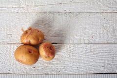 Three potatoes Stock Image