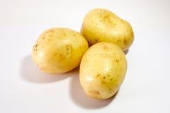 Three Potatoes. White Background Royalty Free Stock Image