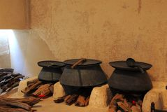 Three   pots. Three pots in an ancient kitchen Stock Photography