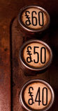 Three pound buttons. Forty, fifty and sixty pound buttons on old cash register Stock Photos