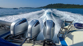 Three powerful engines mounted on the speedboat. Andaman Sea, Thailand. Royalty Free Stock Images