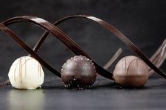 Three pralines. Dessert three pralines chocolate bow Stock Photos