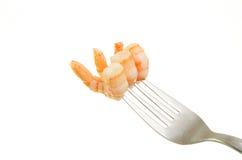 Three prawns on fork Stock Image
