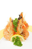 Three prawns on a plate Royalty Free Stock Image