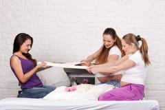 Three pregnant girlfriend Stock Image