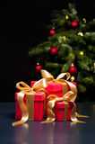 Three presents with gold ribbon Royalty Free Stock Photo