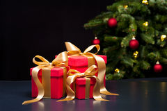 Three presents with gold ribbon Royalty Free Stock Images