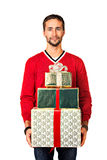 Three presents. Handsome young man holds gifts. Isolated over white Royalty Free Stock Photos