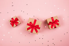 Three presents with red bow on pink royalty free stock image