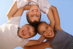 Three preteen friends. Enjoying summer outdoors on blue sky background Royalty Free Stock Image