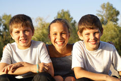 Three preteen friends. Enjoying summer outdoors on blue sky background Royalty Free Stock Photo