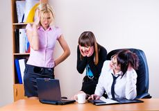 Three pretty businesswomen Stock Images