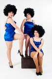 Three pretty dancers with old suitcase Royalty Free Stock Photography