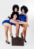 Three pretty dancers with old suitcase Royalty Free Stock Images