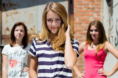 Three pretty happy young women have fun in city outdoors Stock Photography