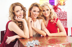 Three pretty women with huge present Royalty Free Stock Images