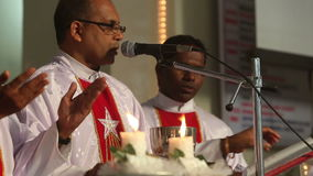 Three priests held a wedding ceremony in the Catholic Church in India stock video