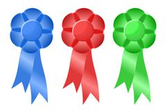 Three Prize Ribbons. Three prize or award ribbons in blue, red, and green symbolic of first, second, and third place competition finishes Royalty Free Stock Photography