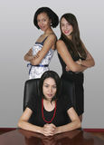 Three professional businesswoman in an office Stock Image