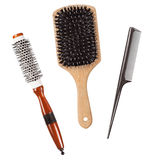 Three professional hairbrushes combs isolated Stock Images