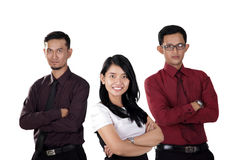Three professional workers with arms crossed Stock Photo