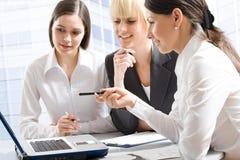 Three professionals Stock Images