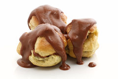 Three profiteroles over white Royalty Free Stock Image