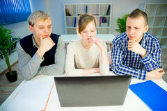 Three programmers at computer. Three programmers are working at stylish office Stock Images