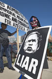 Three protestors in Tucson, AZ of President George W. Bush is holding a sign proclaiming Bush is a Liar regarding the Iraq War Royalty Free Stock Photo