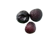 Three prunes. On the white Stock Photo