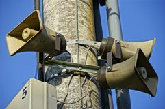 Three public loudspeakers mounted on pillar Stock Photography