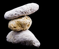 Three Pumice stones on black Stock Image
