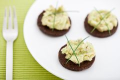 Three pumpernickel slices with guacamole Royalty Free Stock Photography