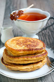 Three pumpkin pancakes Stock Photos