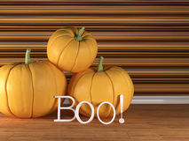 Three pumpkins. Three pumpkin on the floor with boo letters, 3d render Royalty Free Stock Photo