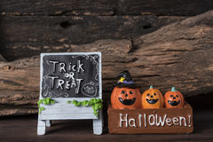 Three pumpkins in the box with trick or treat board Stock Image