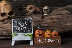 Three pumpkins in the box with trick or treat board Stock Photo