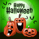 Three pumpkins laugh in a green background Royalty Free Stock Image