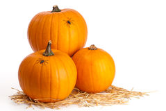 Three Pumpkins On Straw Stock Image