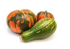 Three pumpkins on white background Stock Photos