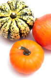 Three pumpkins on white background Royalty Free Stock Photos