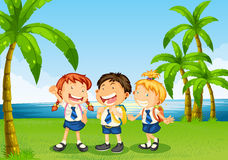 Three pupils at the riverbank Royalty Free Stock Images