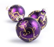 Three purple Christmas balls Royalty Free Stock Photography