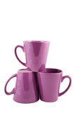 Three purple cups. Over white stock photography