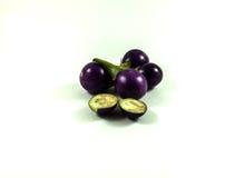 Three purple eggplants on white Royalty Free Stock Photography